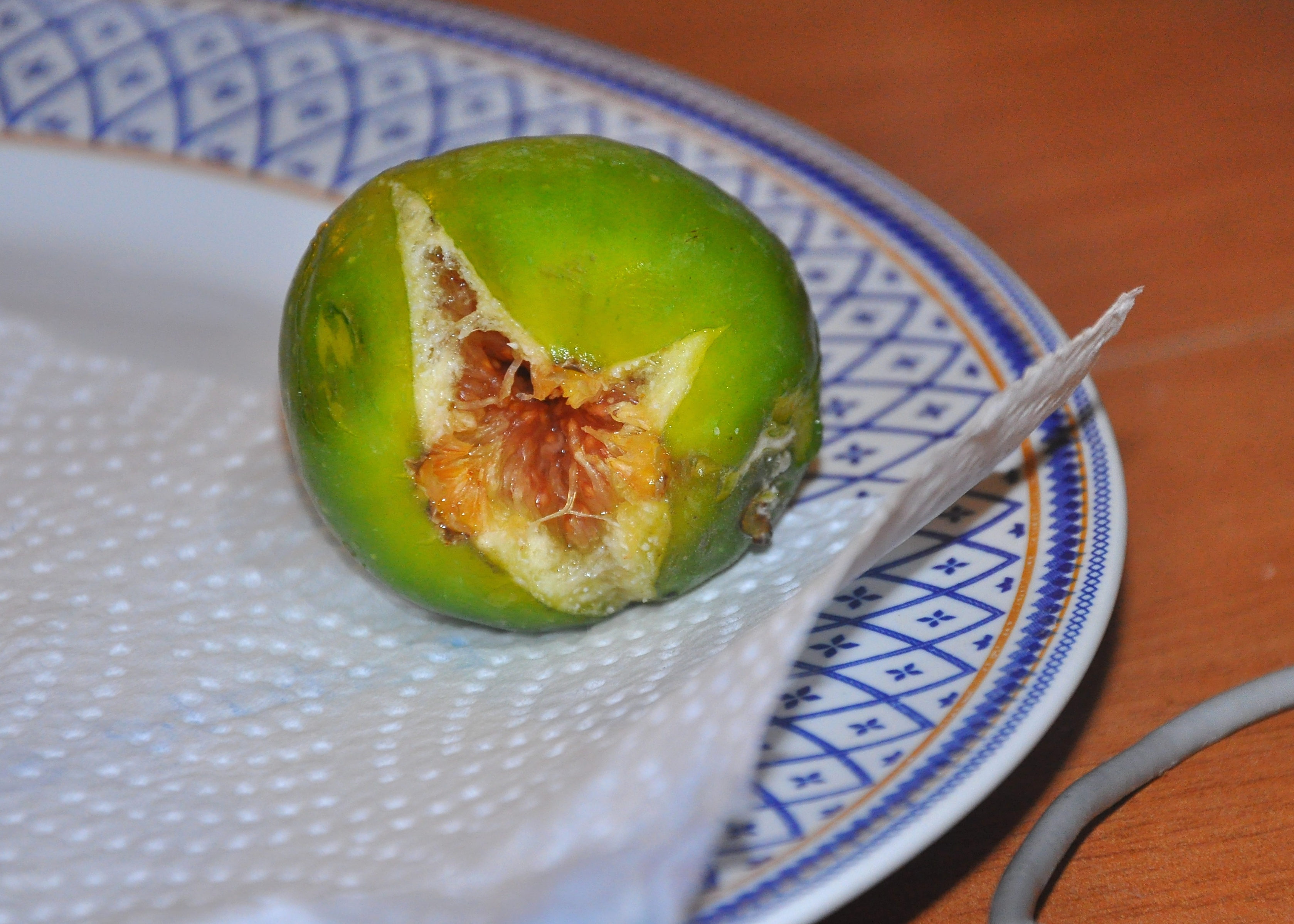 An Italian fig, one type of seasonal summer produce in Italy
