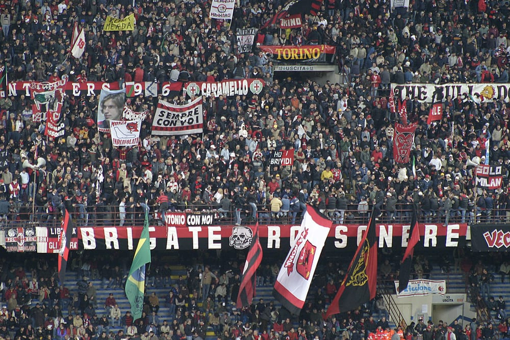 Italians supporting A.C. Milan at an Italian soccer match