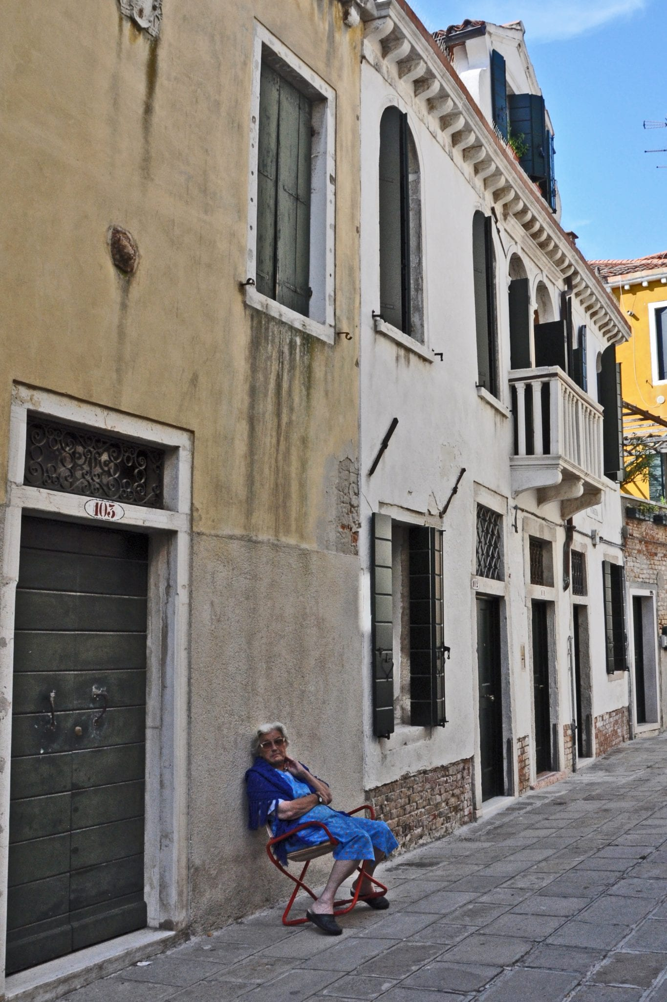 A woman relaxes in the The Castello neighborhood of Venice