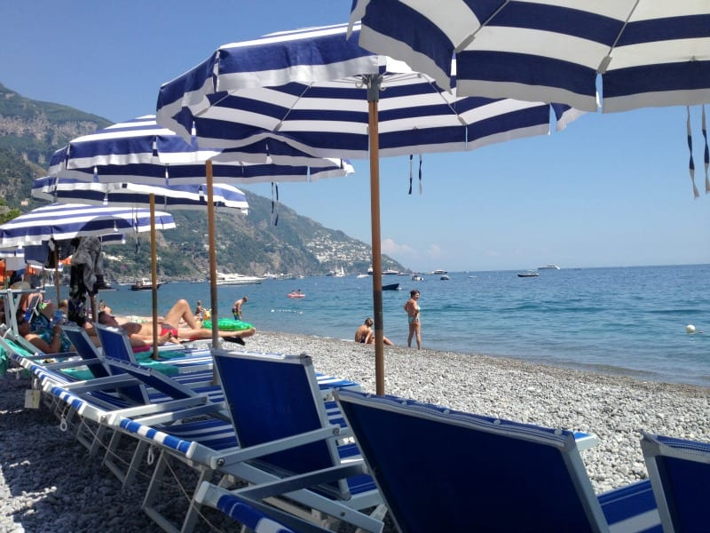 fornillo beach is an amazing place to visit in August in Italy. Find out where to go and what to expect during Italy's most relaxed month.