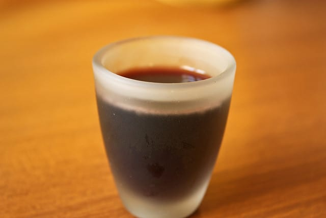 Shot of mirto at a restaurant in Italy