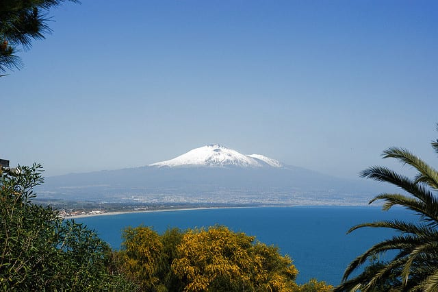 A view of snow capped Mt Etna and the sea (flickr: Allie_Caulfield)