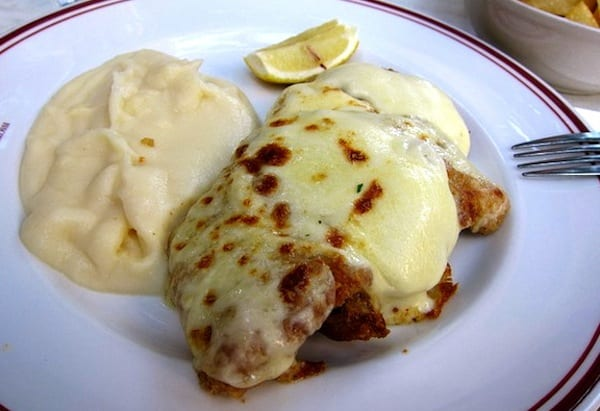 A warm, gooey cotoletta alla valdostana, veal covered in fresh fontina cheese, is the perfect dish after a day touring through the lovely Val d'Aosta Alps. Photo by Jonathan Lin at flickr