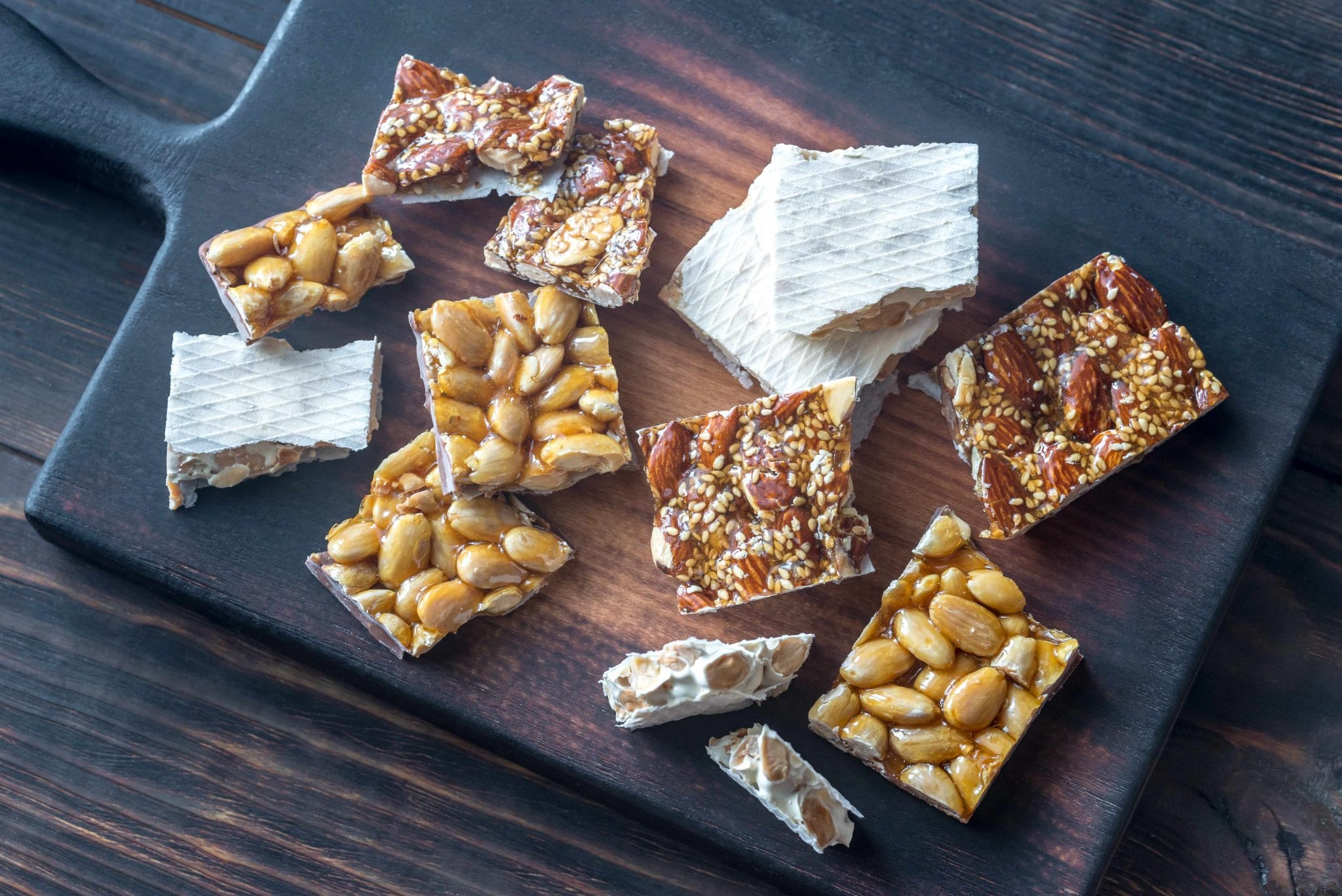 Slices of turron on the wooden board | Source: Stock image