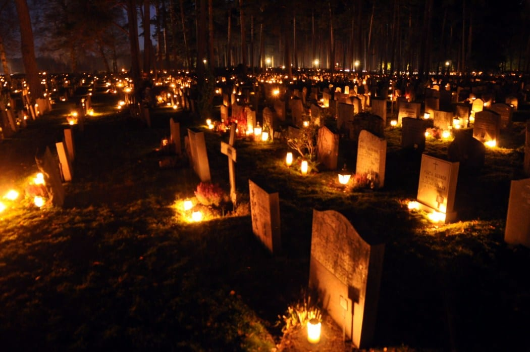 Candles placed on graves on All Soul's Day
